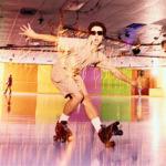 Roller skater posing in retro style roller rink